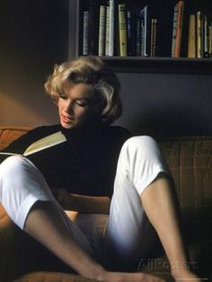 Marilyn Monroe Reading at Home Premium Photographic Print at AllPosters.com