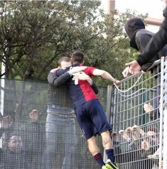 Andrea Cossu (Cagliari) celebrating with the fans