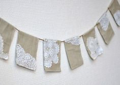 Banner; linen and lace or maybe burlap and paper doilies...