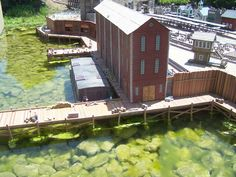 Large Warehouses were common along water fronts a 100 years ago. Many of these Warehouses are still standing today. End doors in this Warehouse are large enough for trains to enter for loading freight to be shipped across Americas great plains. Ice Houses, Great Plains, Warehouses, Water Garden, Vignettes, Trains, America, Doors, Building