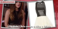 Lucy Hale / Aria Montgomery wears a dress from Alice + Olivia on Pretty Little Liars. She combines it beautifully with a fantastic Twist Stone-Chain Waist Belt.