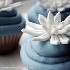 quick cupcake topper idea!  cut 3 fondant petals (small, medium, large) and layer  score with knife  place in an egg carton to hold shape  allow to dry  voila!  cute topper!