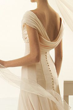 Elegant draping and fine button detail