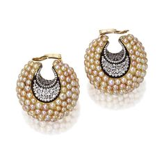PAIR OF NATURAL BUTTON PEARL AND DIAMOND 'CREOLES-CROISSANT' EARCLIPS, JAR, PARIS. The bombé crescents composed of numerous natural button pearls, the centers and below the pearls set with numerous round diamonds weighing approximately 7.85 carats. With signed box. Estimate 50,000 - 70,000 USD / LOT SOLD 110,500 USD [S. MAGNIFICENT JEWELS -  09 DECEMBER 2008 - NEW YORK] #JAR  #JARParis #JoelArthurRosenthal
