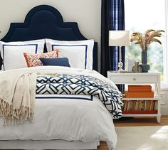 Shelby Geo Duvet & Sham | Pottery Barn, dark blue headboard, blue linen curtains, small bits of orange (don't need much)