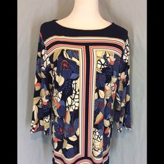 NWOT JM Collection Tunic New without tags, no defects. Polyester/Spandex blend. Navy with blue, coral, beige and white colors. Boat neckline. 3/4 sleeves. Small slits at hemline. Bust 23 inches flat. Length 30 inches. JM Collection Tops Tunics