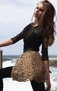 Leopard chiffon mini skirt with a black sheer blouse and black tights...lovely! Womens street style fashion clothing outfit for spring Cool websites where to buy? http://fancyoutletsale.com , http://hautelook.com . like my pins? like my boards? follow me and I will follow you unconditionally and share you stuff if its pretty and cute :D http://www.pinterest.com/shopfancytemple/