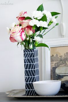 DIY chalkboard vase, though I think I would use normal acrylic paint because I wouldn't want to ruin a design that nice!