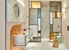 Contemporary bathroom designed by Pepe Leal, mixing modern materials like marble and copper.