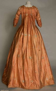 Oh the color! The luxurious brocade! Salmon/shrimp brocade sack back open robe, back view, 1765-1775. @Augusta Hamilton Auctions