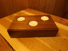 This Hardwood Tea Light Holder made from Walnut has a triangular configuration for the Tea Light Candles. The holder has very even grain appearance and the end grain shows nice growth ring detail. Several coats of Minwax Semi-Gloss Polyurethane was applied for a long lasting finish. Tea Light Candles are included. http://www.crafttables.net