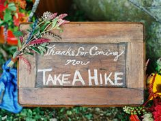 Cute sign for a woodsy, outdoor wedding.
