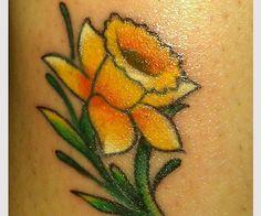 fight against cancer daffodil 20 Wonderful Daffodil Tattoo Designs Ankle Tattoo, Wrist Tattoos, S Tattoo, Flower Tattoos, Body Art Tattoos, New Tattoos, Sleeve Tattoos, Cool Tattoos, Tatoos