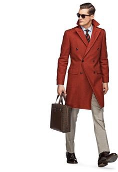 A great autumn business outfit by Suit Supply! The neutral shirt and trousers along with a tie and coat that works very well together works great with the polished brown leather shoes and briefcase.