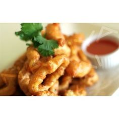 Fried Calamari Appetizer:Calamari lightly battered and fried to golden brown, served with sweet and sour sauce from Nariya Thai Restaurant in Blvd, Los Angeles #Food #Appetizer forked.com