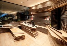 Stacked wooden boards define the interior landscape of Osaka's new Shun*Shoku Lounge By Gurunavi. The 1,000 square foot lounge, designed by Kengo Kuma and Associates, functions as a cafe, information booth and public relations space for Gurunavi – a company who connects people with high quality restaurants. |
