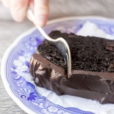 Death By Chocolate Zucchini Cake with a bittersweet chocolate ganache is the ultimate zucchini dessert! from @slmoran21