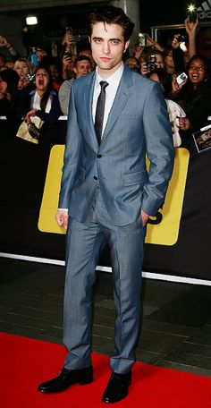 A smoldering Robert Pattinson hit the Breaking Dawn—Part 1 Los Angeles premiere in a slim Gucci suit.
