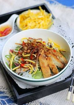 Mixture Glass Vermicelli with Dried Squid (Miến Trộn Mực Khô) - Mixture Glass Vermicelli with Dried Squid. Many interesting stuffs on top of bowl like crispy dried squids, fish sticks, glass vermicelli, vegetables etc … will bring an amazing flavor in your mouth.   Ingredients  - 1 – 2 dried squids - 200g chopped fish (Chả cá) – buy at Asian Markets - 2 chicken eggs - Purple onion, salt, sugar, pepper, fish sauce, chili - Bean sprout, cabbage - Glass vermicelli, roasted peanut Process…