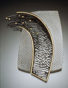 Carol Webb, Curve Pin, etched and patinated copper, fine silver laminate, etched through copper, 22k gold, 3 x 2 x 1/4 inches