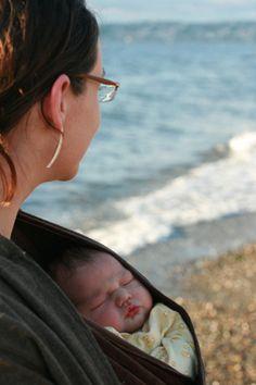 Newborn baby in wrap on the beach - http://baybcare.com/general/newborn-baby-in-wrap-on-the-beach/