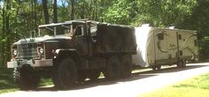 """5-Ton"""" M923A2 Military truck towing a 2015 Grand Design Reflection 313RLTS travel trailer"""