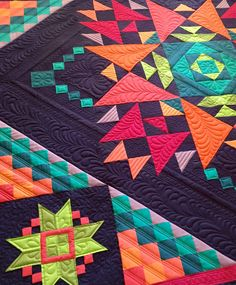 Amish with a Twist quilt--the pieces version. This is the original quilt sewn and quilted by Nancy Rink using Marcus Fabrics' Centennial Solids