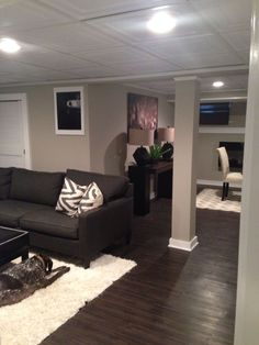 Basement remodel - love the dark floors Different ceiling tiles are nice. And the framed out post looks good.