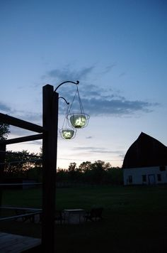 How to make a DIY hanging solar light by upcycling glass bowl light shades off of a chandelier and a couple of dollar store items. Solar Chandelier, Outdoor Chandelier, Outdoor Lighting, Lighting Ideas, Solar Lamp, Solar Light Crafts, Diy Solar, Garden Lamps, Diy Garden Decor
