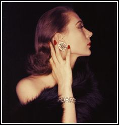 Model wearing jewels, 1954. Photo by Clifford Coffin.