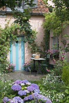 A little quaint quiet garden sandwiched between a small house and a smaller coach house...