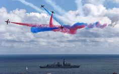 RAF Red Arrows at Bournemouth Air Show.   HMS Iron Duke in foreground