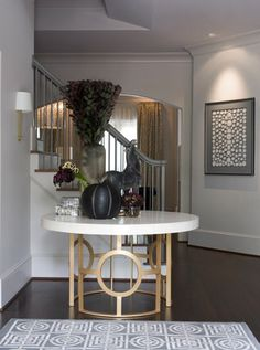 Foyer table is amazing...I'm a lover of brass!