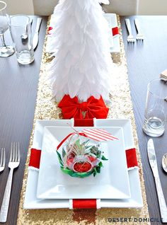 Present place settings – wrap some wired ribbon around a large square plate and add a bow at the top!