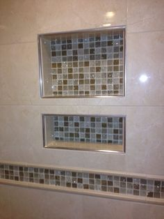 Photo of Equity-Plus Construction - Chicago, IL, United States. Shower niche with glass mosaic tile and schluter edging