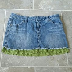 Jean skirt Jean skirt with green lace. Tag says size 9 lei Skirts