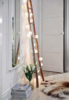 Twinkle lights, pale wood floors, furry rug.