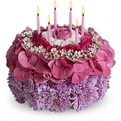 "Your Special Day  Tell the birthday girl to make a wish on these candles! Made entirely of fresh flowers, this delightful ""cake"" will really make her day special."
