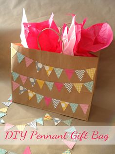 This DIY Pennant Flag Bag from Silver Boxes is an easy and adorable idea for a bridal or baby shower!