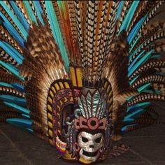 There's nothing like staying up til 12:25 on a sunday night/ monday morning searching pictures of mexico on pinterest...this was number 4 on my results page i love the coloring and all the feathers
