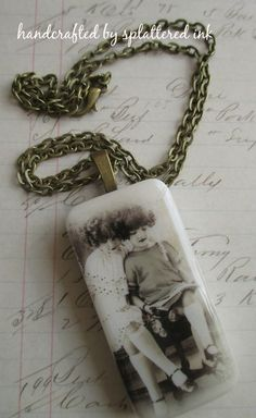 http://folksy.com/items/6450261-Vintage-girls-altered-domino-pendant