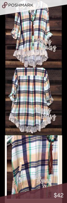 "Plus Size Plaid Lace Hem Tunic Top XL 1X 2X Shirt If you love plaid and you love lace, this is the top for you. Button down, collared, front pockets, and with a high low lace trimmed hemline.  Soft cotton blend fabric. This is definitely oversized. Length is taken from top of shoulder down in the front and the back. Bust is measured lying flat across chest. XL - 24"" underarm to underarm. 31"" front and back is 36"" 1X - 25"" underarm to underarm. 31.5"" front and back is 36.5"" 2X - 26"" underarm…"