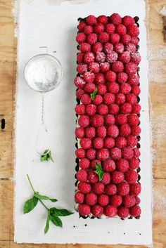 Raspberry + coconut tart. HELL TO THE YES.