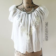"""F21 Billowy Embroidered Crop Top NWT. Major Coachella vibes from this pretty top! Elastic neckline with puff sleeves and a curved cropped hem. Polyester with floral pattern in cotton embroidery. Brand new with tags! Cream color. Length is about 18"""" and bust is 20"""" when laid flat. Very loose and flowy fit. Juniors size L. From Forever 21. Thanks for looking! Forever 21 Tops Crop Tops"""