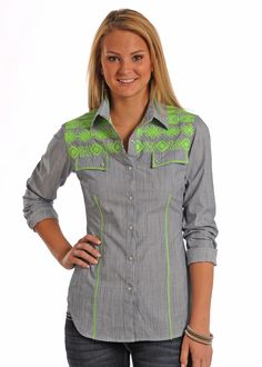 This gorgeous new shirt from Rock & Roll Cowgirl is sure to bring out the cowgirl in you! Along the shoulder area a beautiful neon green embroidery pattern lays on top of a chambray texture through th