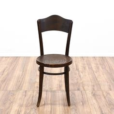 """This """"Thonet"""" Bentwood dining chair is featured in a solid wood with a dark finish. This side chair has a round seat, round stretchers, and sabre legs. Perfect for cafe seating! #europeaninspired #chairs #chair #sandiegovintage #vintagefurniture"""