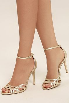 Exquisitely elegant, the Jewel by Badgley Mischka Haskell II Gold Ankle Strap Heels are ready for any special occasion! Metallic gold faux leather forms an art-deco-inspired, peep-toe upper and adjustable ankle strap (with gold buckle). Single Strap Heels, Gold Ankle Strap Heels, Ankle Straps, Giuseppe Zanotti Heels, Prom Heels, Hot High Heels, Black Heels, Studded Heels, Fashion Heels