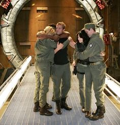 This Stargate SG-1 series wrap picture always looks so much more sad to me, there seems to be almost a separation between them; Amanda, Michael and Christopher, and Ben and Claudia...