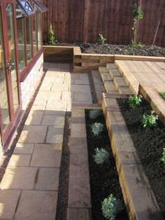Retaining wall, steps and decking made of railway sleepers - Garden Decoration Garden Retaining Wall, Sloped Garden, Retaining Walls, Sleeper Retaining Wall, Small Retaining Wall, Back Garden Design, Garden Landscape Design, Sloped Backyard Landscaping, Landscaping Ideas