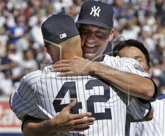 Jeter hugs Mariano Rivera as the Yankees celebrate their Hall-of-Fame bound closer in what was his final season in pinstripes. Yankees Baby, Yankees Team, Damn Yankees, New York Yankees, New York Teams, Last Game, Babe Ruth, Derek Jeter, Team Photos